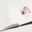 Страницы фотокниги скреплены  книжным переплётом